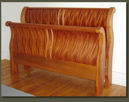 Our Ribbon Mahogany Crowley Sleigh Bed features shop-sawn ribbon mahogany veneers