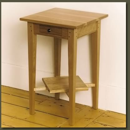 A delicate drawer and angled shelf make our Red Birch End Table highly functional and decorative