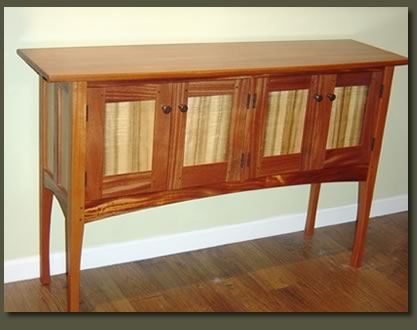 Our Myrtle Madness Sideboard is made with two uniquely beautiful woods:  Ribbon Mahongany and Myrtle