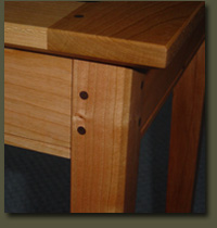 Clarner Woodworks uses the highest quality of craftsmanship when making its handcrafted Wedding Table. Details include clean, classic lines and walnut pegged mortise and tenon joinery